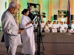West Bengal Governor Keshari Nath Tripathy administers the oath of secrecy to West Bengal Chief Minister Mamata Banerjee during swearing-in ceremony in Kolkata