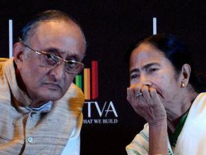 Mamata Banerjee with State Finance Minister Amit Mitra