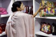 West Bengal CM Mamata Banerjee admires bags