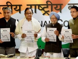 Former Prime Minister Manmohan Singh with former Finance Minister P Chidambaram , Congress spokesperson Randeep Surjewala and Prof. Rajeev Gowda releases 'The REAL State of Economy Report- 2017