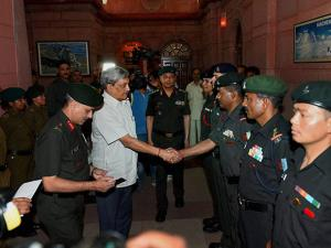 Defence Minister Manohar Parrikar meeting  NCC cadets who  successful scale Mt Everest, in South Block, New Delhi