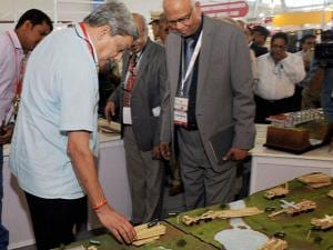Union Defence Minister Manohar Parrikar looking at exhibits during the inauguration