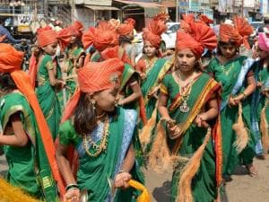 School girls take part in a rally on the occasion of  'Marathi Bhasha Diwas' in Karad