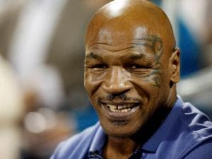 Mike Tyson attends a World Team Tennis exhibition