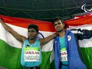 Mariyappan Thangavelu and Varun Singh Bhati walk with India's flag