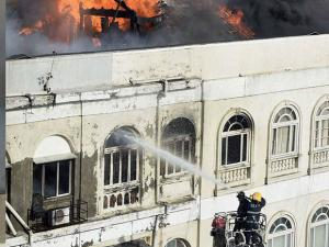 Fire men dousing a major fire at building on the Colaba Causeway in south Mumbai (2)