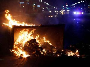 A fire burns during protests in Oakland, Calif