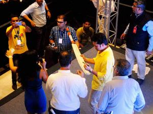 Former Cricketer Sachin Tendulkar gives autographs to his fans at a function in Noida