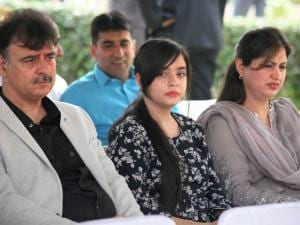 Family members of Jammu and Kashmir Chief Minister Mehbooba Mufti attend her after Oath taking ceremony,at Raj Bhawan in Jammu.