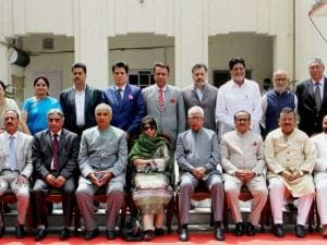 Jammu and Kashmir Governor NN Vohara along with Chief Minister Mehbooba Mufti and her cabinet poses for a group photo at Raj Bhawan in Jammu
