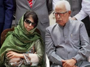 Jammu and Kashmir Governor NN Vohara talks with New Chief Minister of the state Mehbooba Mufti after taking Oath,at Raj Bhawan in Jammu.