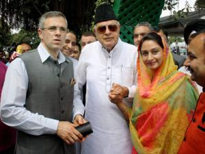 Union Minister Harsimrat Kaur Badal with former Union Minister Farooq Abdullah and former J&K chief minister Omar Abdullah during oath taking ceremony of new J&K Chief Minister Mehbooba Mufti