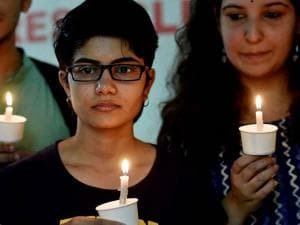Members of LGBT (lesbian, gay, bisexual, and transgender) community observe a candlelight vigil to pay tribute to victims of a massacre at a gay club in the US city of Orlando, in Chennai (2)