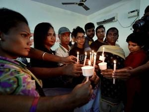 Members of LGBT (lesbian, gay, bisexual, and transgender) community observe a candlelight vigil to pay tribute to victims of a massacre at a gay club in the US city of Orlando, in Chennai (3)