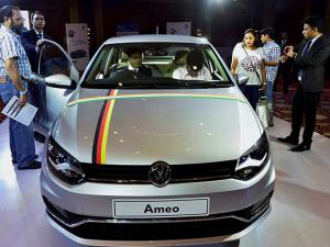 People inspecting a Volkswagen Passenger Car 'Ameo' in New Delhi