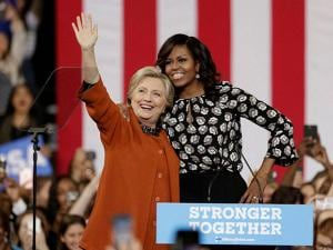Democratic presidential candidate Hillary Clinton, accompanied by first lady Michelle Obama