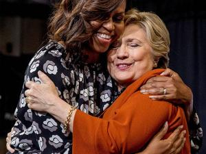 Hillary Clinton, accompanied by first lady Michelle Obama