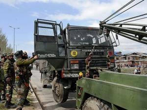 An army truck being toed away after it was targeted by militants near a hospital along Parimpora-Panthachowk bypass road in Srinagar