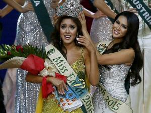 Katherine Espin of Ecuador reacts shortly after being crowned Miss Earth 2016 by last year's winner Angelia Ong of the Philippines