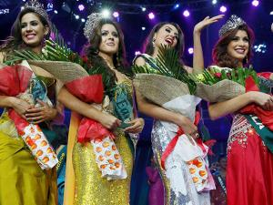 Winners for the Miss Earth 2016 pose for photographers following the grand coronation night