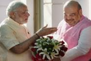 Prime Minister Narendra Modi is greeted by BJP President Amit Shah