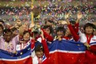 Members of the North Korean women's soccer team celebrate