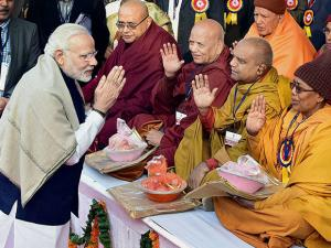 Prime Minister Narendra Modi greets monks of Dr Ambedkar Foundation