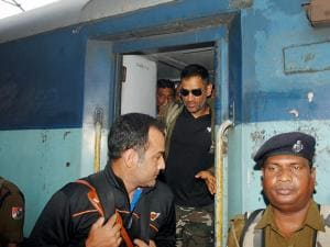 Jharkhand captain M S Dhoni with his teammates deboards as they arrive at Howrah Station