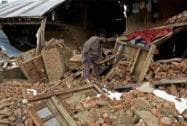 A damaged house after a landslide at Chadoora in Budgam