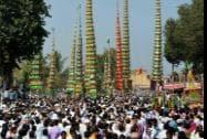 Muslims carry Taziyas during a Muharram procession at Kadegaon village in Sangli