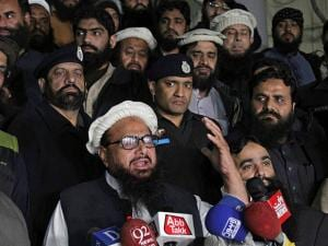 Hafiz Saeed, leader of the Pakistani religious group and charity,  Jamaat-ud-Dawa addresses his supporters outside the party's headquarters