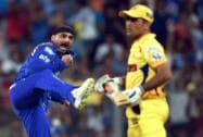Mumbai Indians' player Harbhajan Singh celebrates the wicket of Chennai Super Kings Captain MS Dhoni