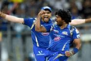 Mumbai Indians' player Lasith Malinga and Rohit Sharma  celebrate the wicket of CSK's Dwayne Smith