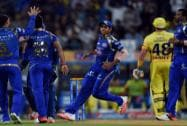 Mumbai Indians' players celebrate the wicket of CSK's Michael Hussey