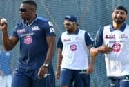 Kieron Pollard with Harbhajan Singh and Rohit Sharma during a practice session in Mumbai
