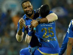 Mumbai Indians player Krunal Pandya  celebrate with  K Pollard after taking the wicket of AB de Villiers during the IPL match against Royal Challengers Bangalore in Mumbai