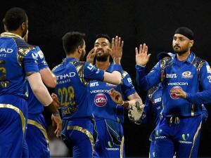 Mumbai Indians players celebrate the wicket of KL Rahul of Royal Challengers Bangalore during their IPL match in Mumbai
