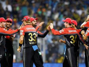 Royal Challengers Bangalore players celebrates the wicket of Parthiv Patel during the IPL match against Mumbai Indians in Mumbai