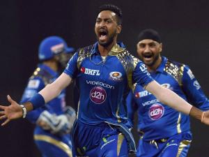 Mumbai Indians player Krunal Pandya celebrate the wicket of AB de Villiers during the IPL match against Royal Challengers Bangalore in Mumbai