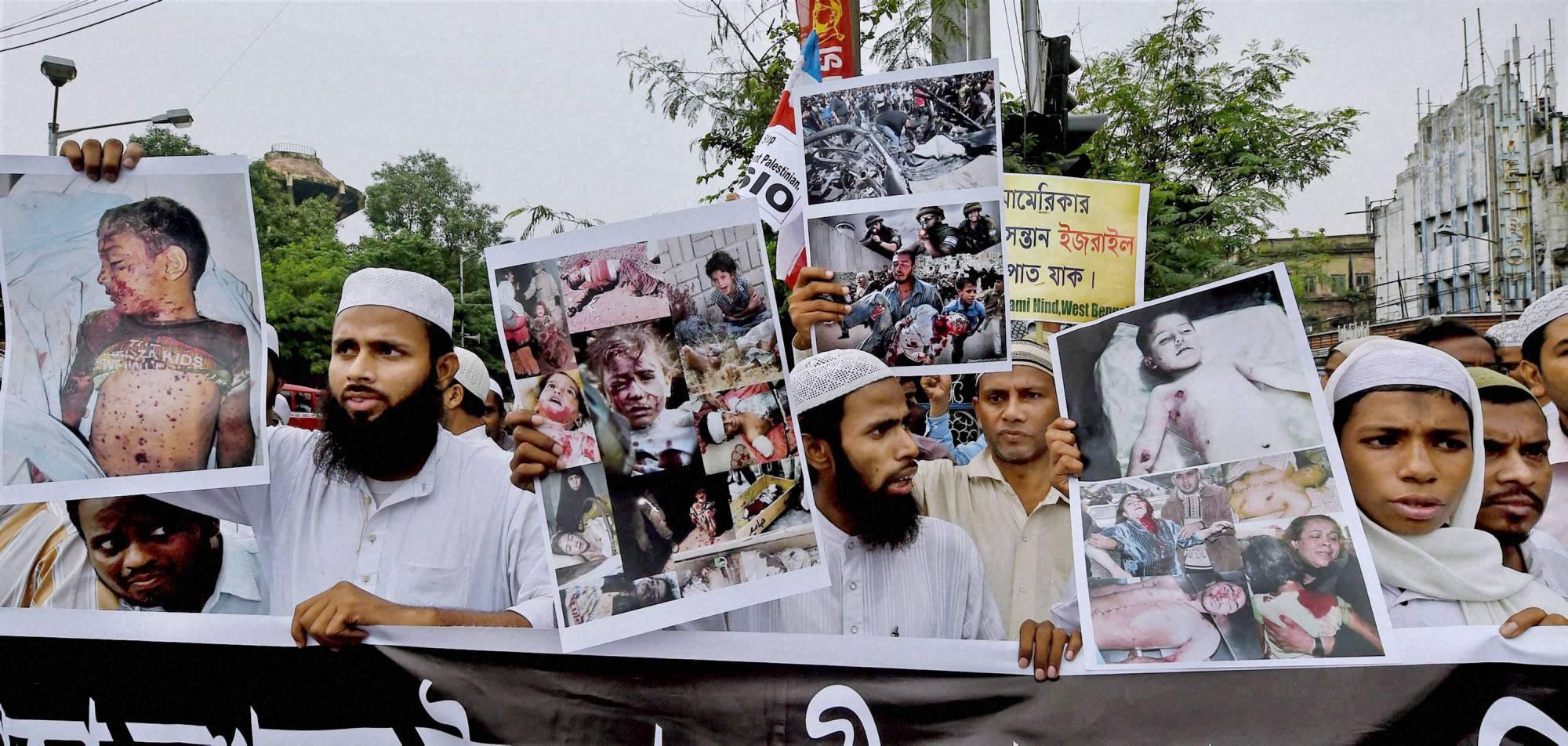 Muslims, display posters,protest, against Israel's, military, operation, Gaza, kolkata
