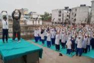 Muslim girls practicing Yoga