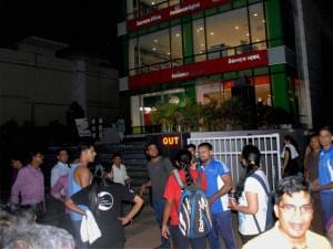 People coming down from a multi-storey commercial building after tremor felt in Bhubaneswar.