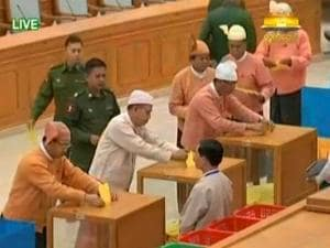 In this image made from video provided by Myanmar Parliament Television, members of parliament cast their ballots for the country's new president in Naypyitaw