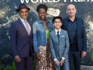 Giancarlo Esposito, from left, Lupita Nyong'o, Neel Sethi and Ben Kingsley arrive at the premiere of The Jungle Book at the El Capitan Theatre.