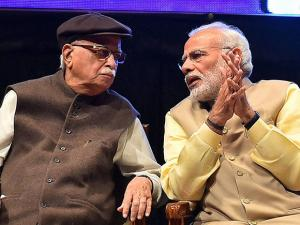 Narendra Modi and BJP Senior leader L K Advani during the launch of Shraddheya Kidarnath Sahni Smriti Granth