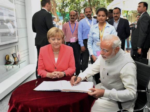 Narendra Modi, Angela Merkel, Merkel Modi Meeting, narendra modi, India Germany Talks, Merkel Modi, Merkel in Bengaluru, Merkel Bengaluru