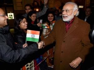 Prime Minister Narendra Modi meets Indian community people outside his hotel on his arrival in Brussels