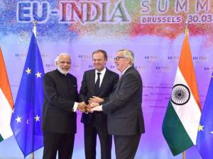Prime Minister Narendra Modi, European Commission President Jean-Claude Juncker and  European Council President Donald Tusk  join hands during the EU-India Summit at  EU Headquarters in Brussels, Belgi