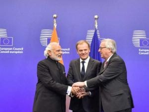 Prime Minister Narendra Modi, European Commission President Jean-Claude Juncker and  European Council President Donald Tusk join hands during the EU-India Summit at  EU Headquarters in Brussels, Belgiu