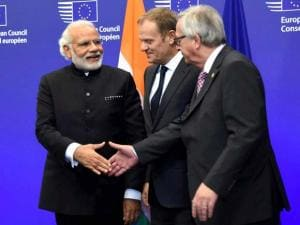 Prime Minister Narendra Modi greets European Commission President Jean-Claude Juncker as Union President Donald Tusk looks on at EU Headquarters in Brussels, Belgium